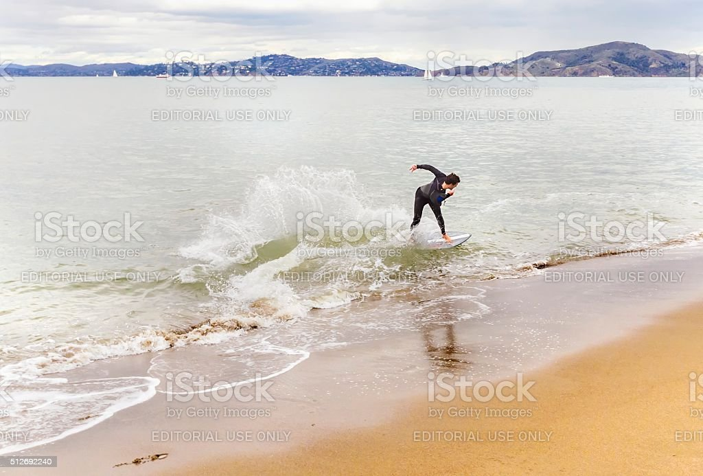 Skimboarding in San Francisco Bay, California stock photo