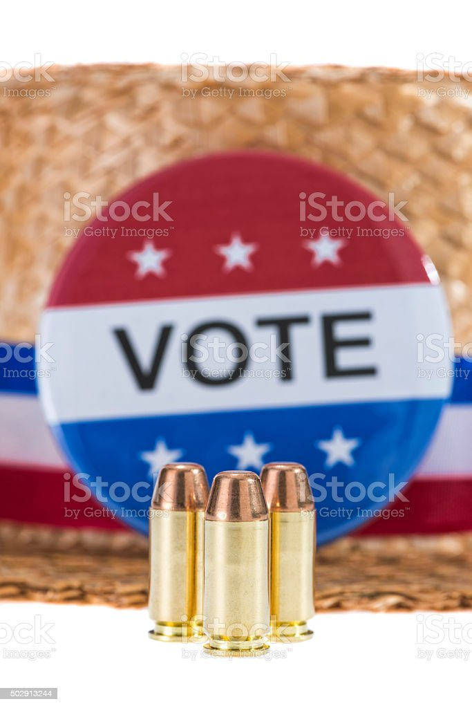 Skimmer hat with VOTE button, bullets on white background stock photo