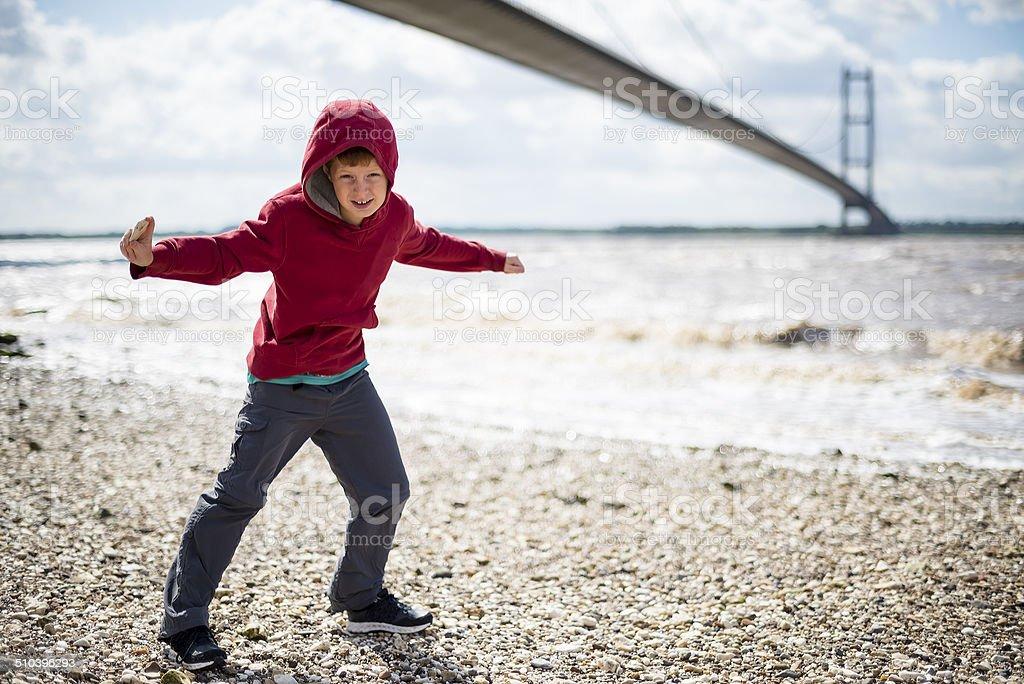Skimming stones at the Humber Bridge stock photo