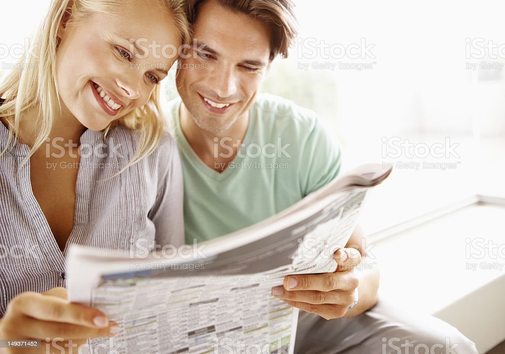 Skimming the property section stock photo