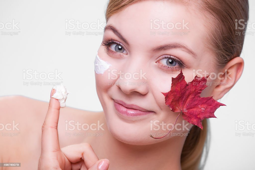 Skin care. Face of young woman girl with maple leaf. royalty-free stock photo