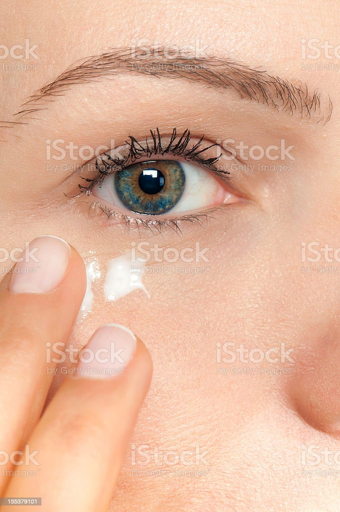 Skin care woman putting face cream royalty-free stock photo