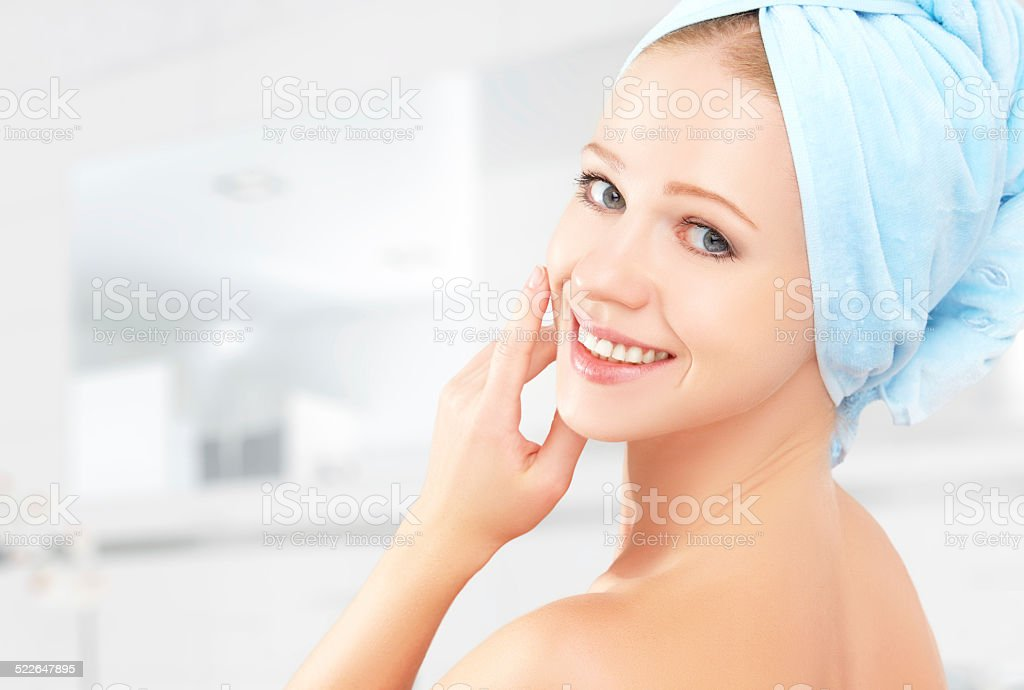 skin care. young beautiful healthy girl in towel in bathroom stock photo