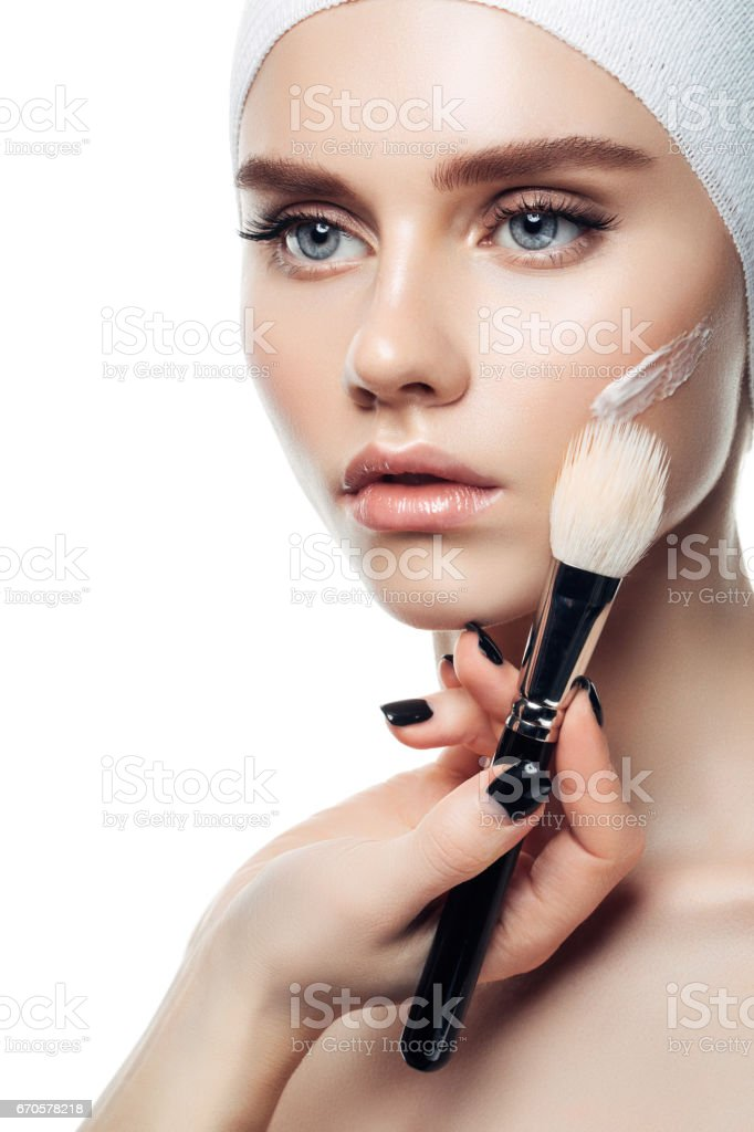 Skin cream lines on woman face stock photo