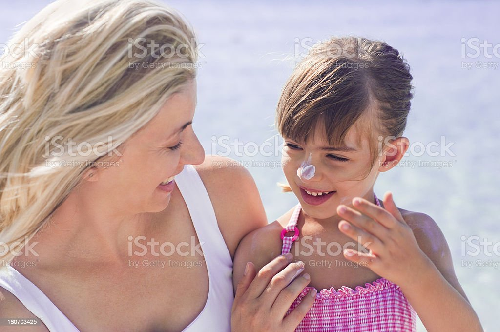 Skin protection at the beach royalty-free stock photo