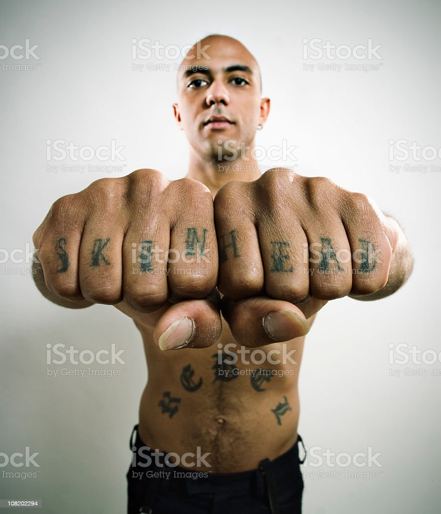 Skinhead Showing off Knuckle tattoo royalty-free stock photo