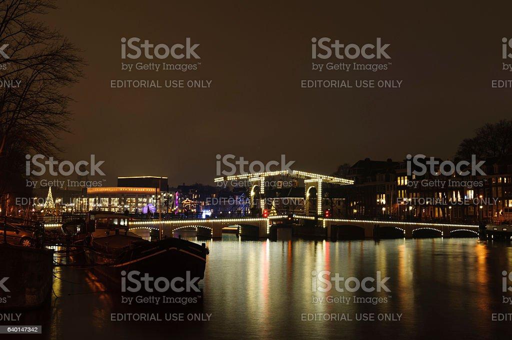 skinny bridge amsterdam at night stock photo