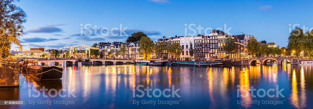 Skinny Bridge and Amstel Canal at twilight Amsterdam Holland stock photo