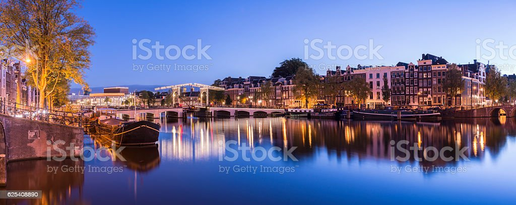 Skinny Bridge in Amsterdam at twilight, Holland stock photo