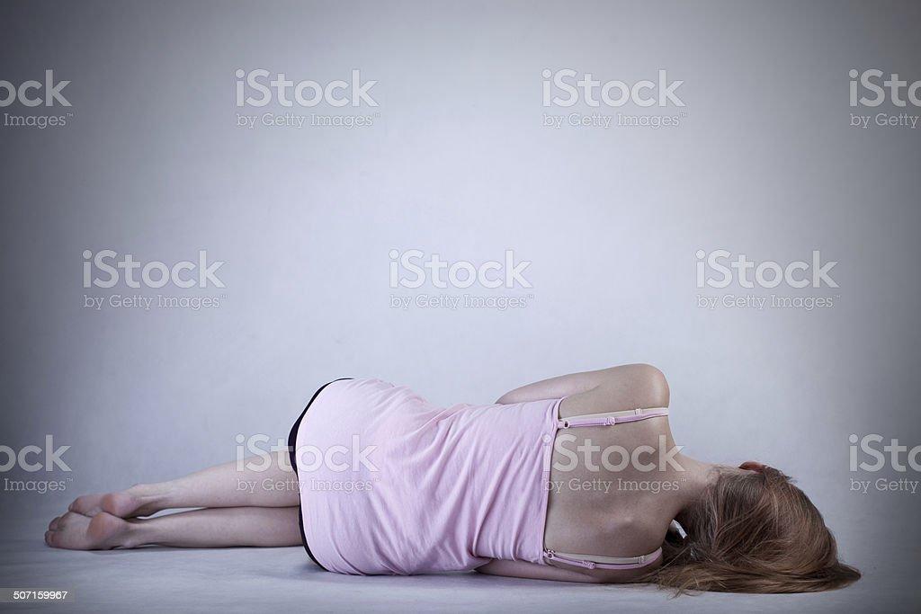 Skinny girl lying on the floor stock photo