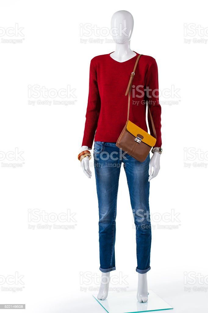 Skinny jeans and red sweater. stock photo