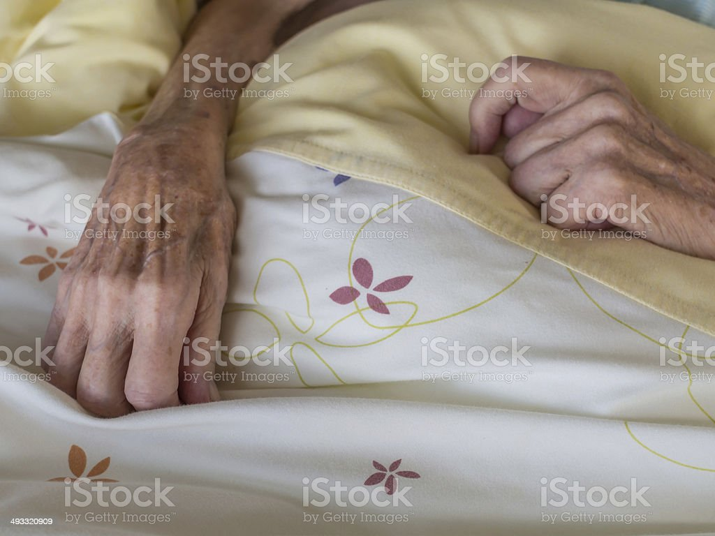 Skinny old hands stock photo