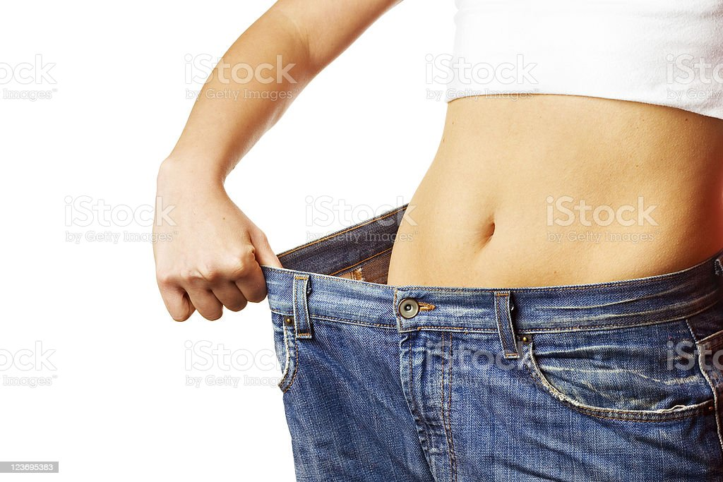Skinny person in big jeans to document waist size lost royalty-free stock photo