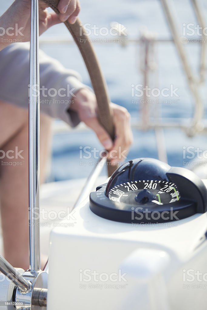 skipper driving a yacht royalty-free stock photo