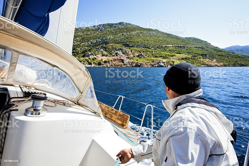 Skipper driving sailing ship royalty-free stock photo