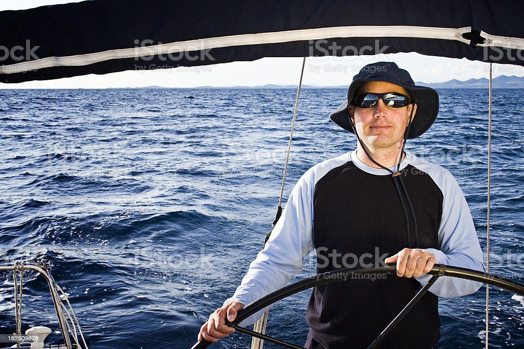 Skipper driving sailing ship royalty-free stock photo