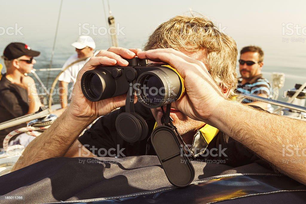 Skipper looking thru binoculars royalty-free stock photo