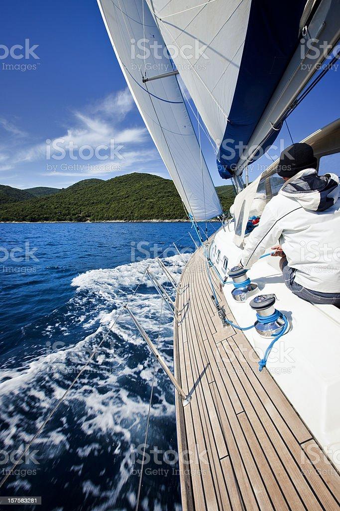Skipper sailing with sailboat royalty-free stock photo