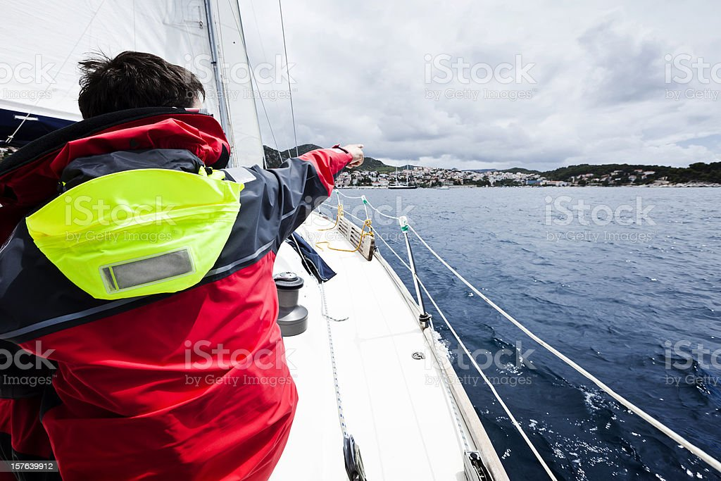 Skipper sailing with sailboat royalty-free stock photo