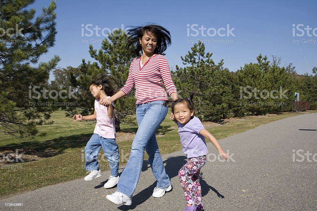 Skipping through the park. stock photo