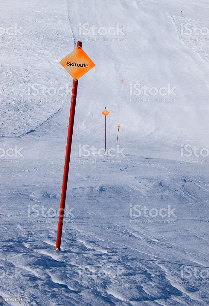 Skiroute signs on empty piste stock photo