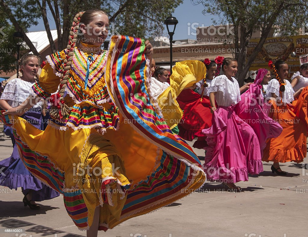 Skirts Swirl in Authentic Mexican Folk Dancing stock photo