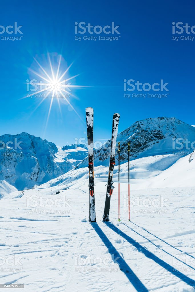 Skis and ski poles on remote slope stock photo