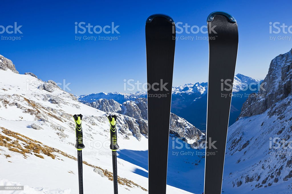 Skis and ski poles on top of slope royalty-free stock photo