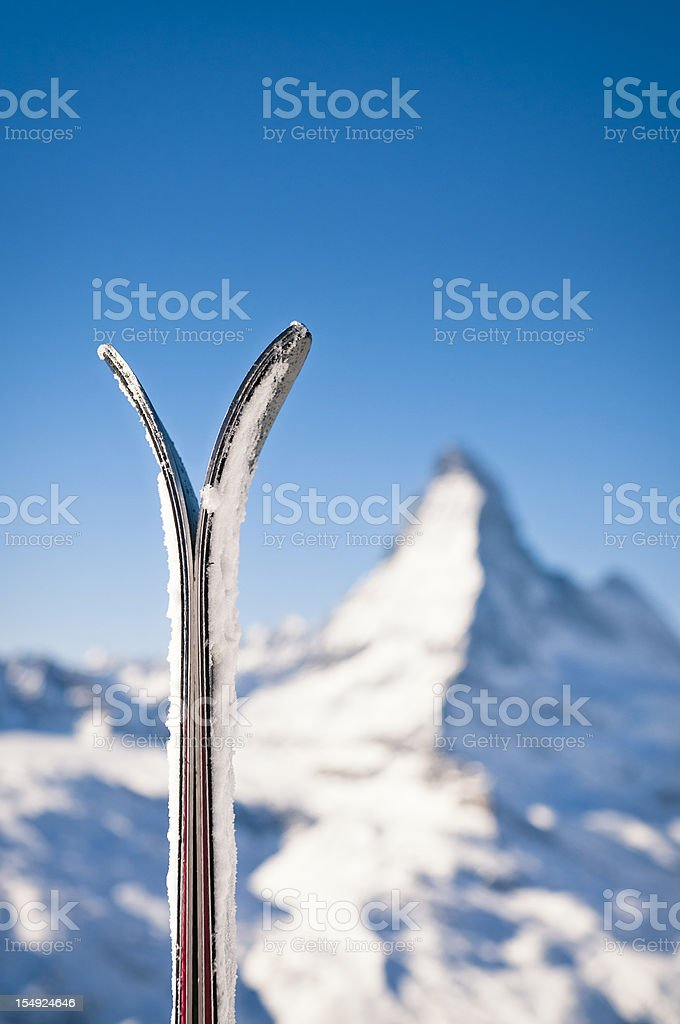 Skis and the Matterhorn stock photo