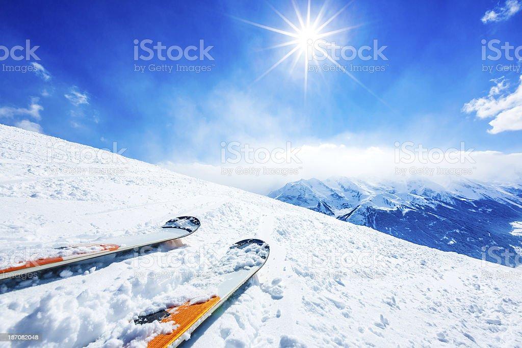 Skis on ski resort slope stock photo
