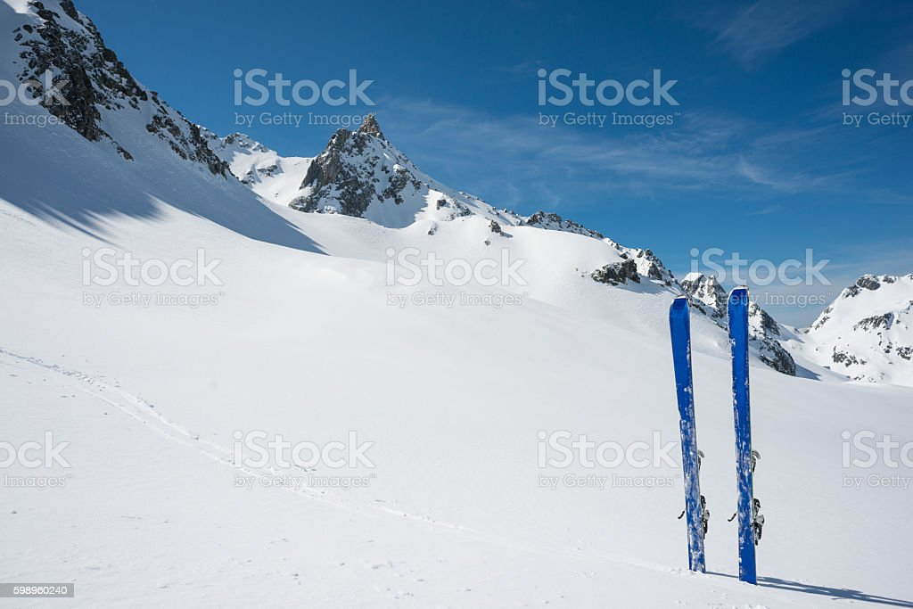 Skis planted in the snow stock photo
