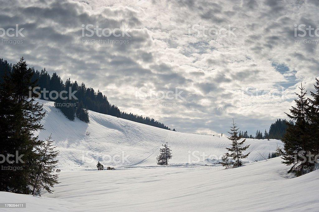 Ski-slope and Moody Sky stock photo