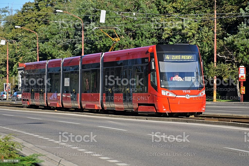 Skoda 30T ForCity Plus tram driving on the street stock photo