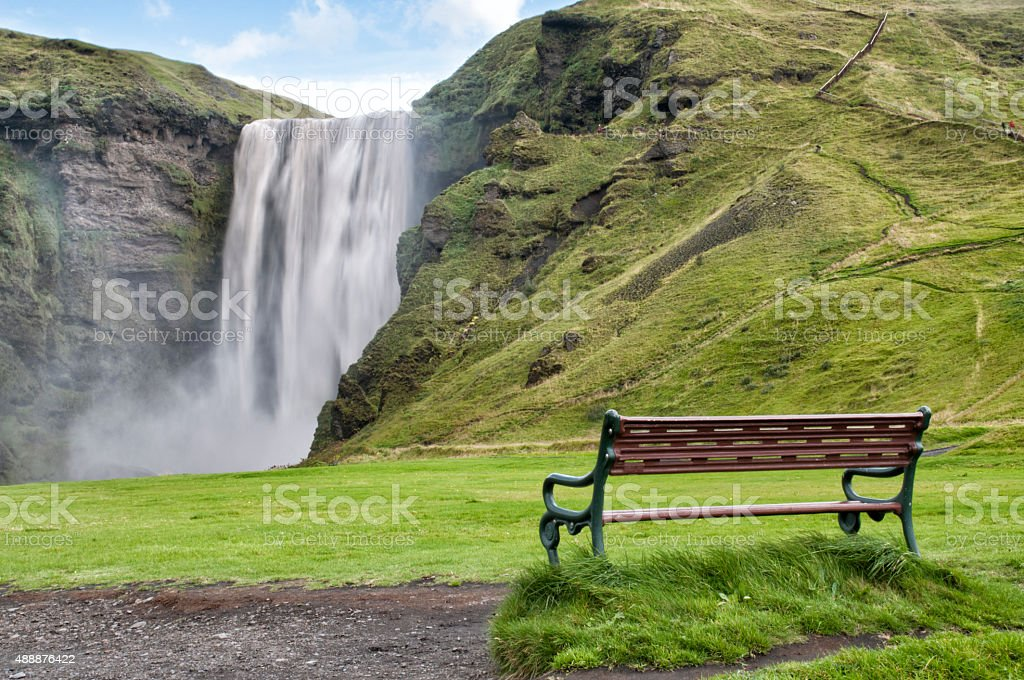 skogafoss with an empty chair stock photo