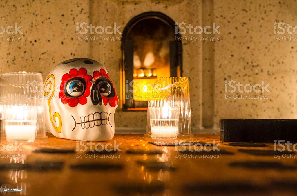 Skull adorned on tomb, Oaxaca, Mexico stock photo