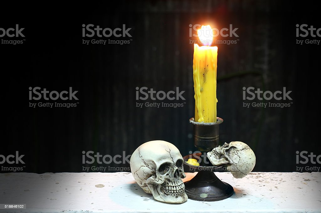 Skull and candle, still life concept stock photo