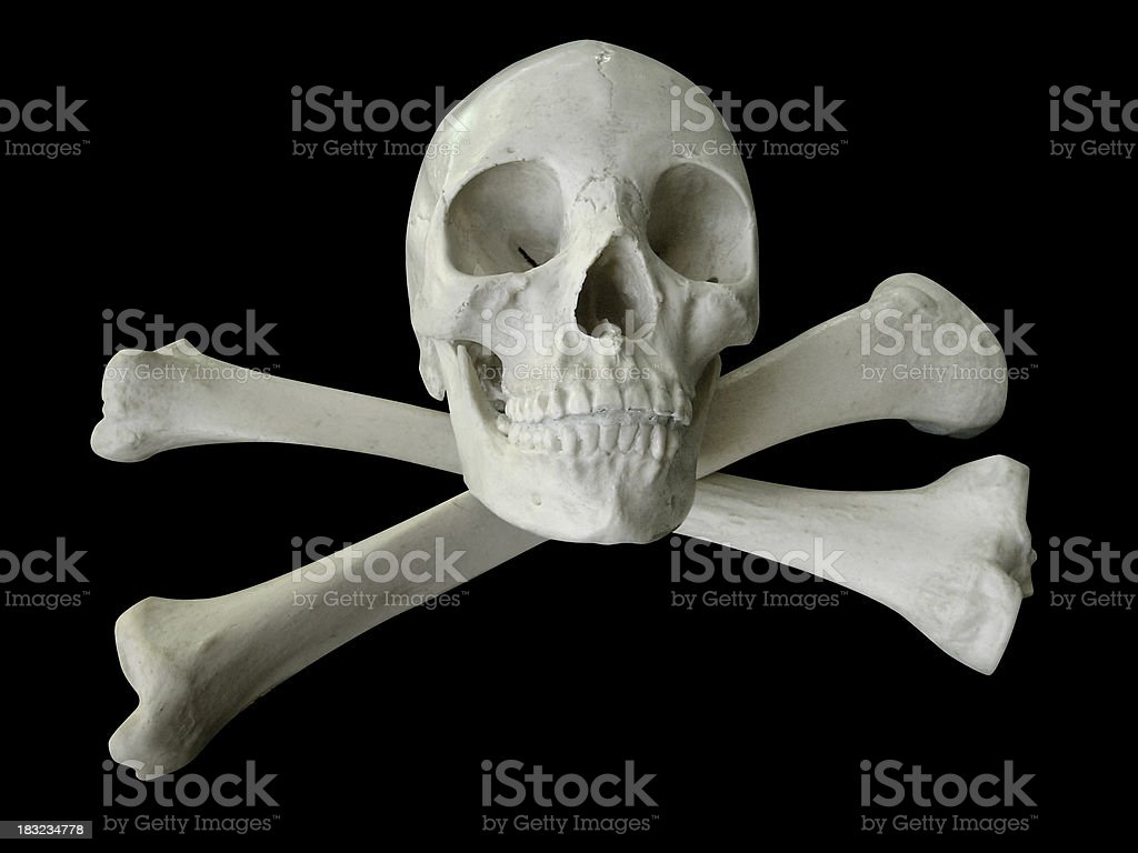 Skull and crossbones - black bkgd royalty-free stock photo