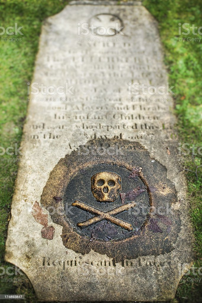Skull and crossbones, stone tombstone, shift tilted stock photo