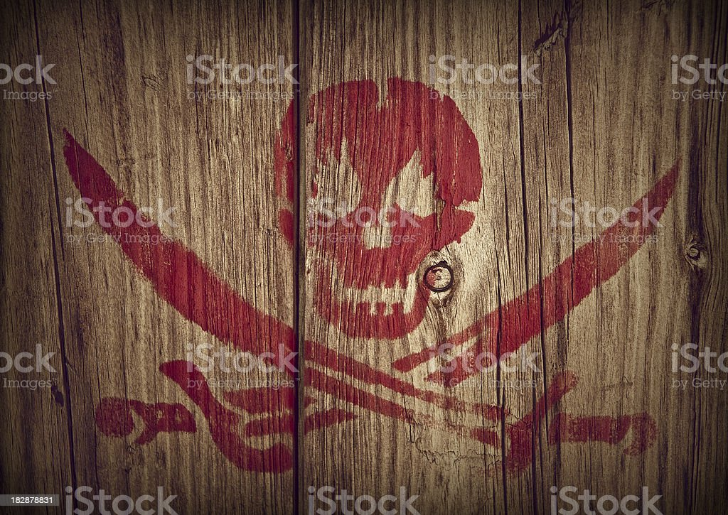skull and crossing swords stock photo