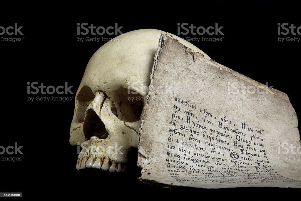 skull and manuscript stock photo