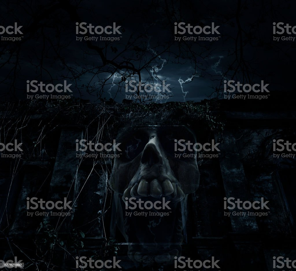 Skull blend with ancient castle over cloudy sky, Halloween concept stock photo