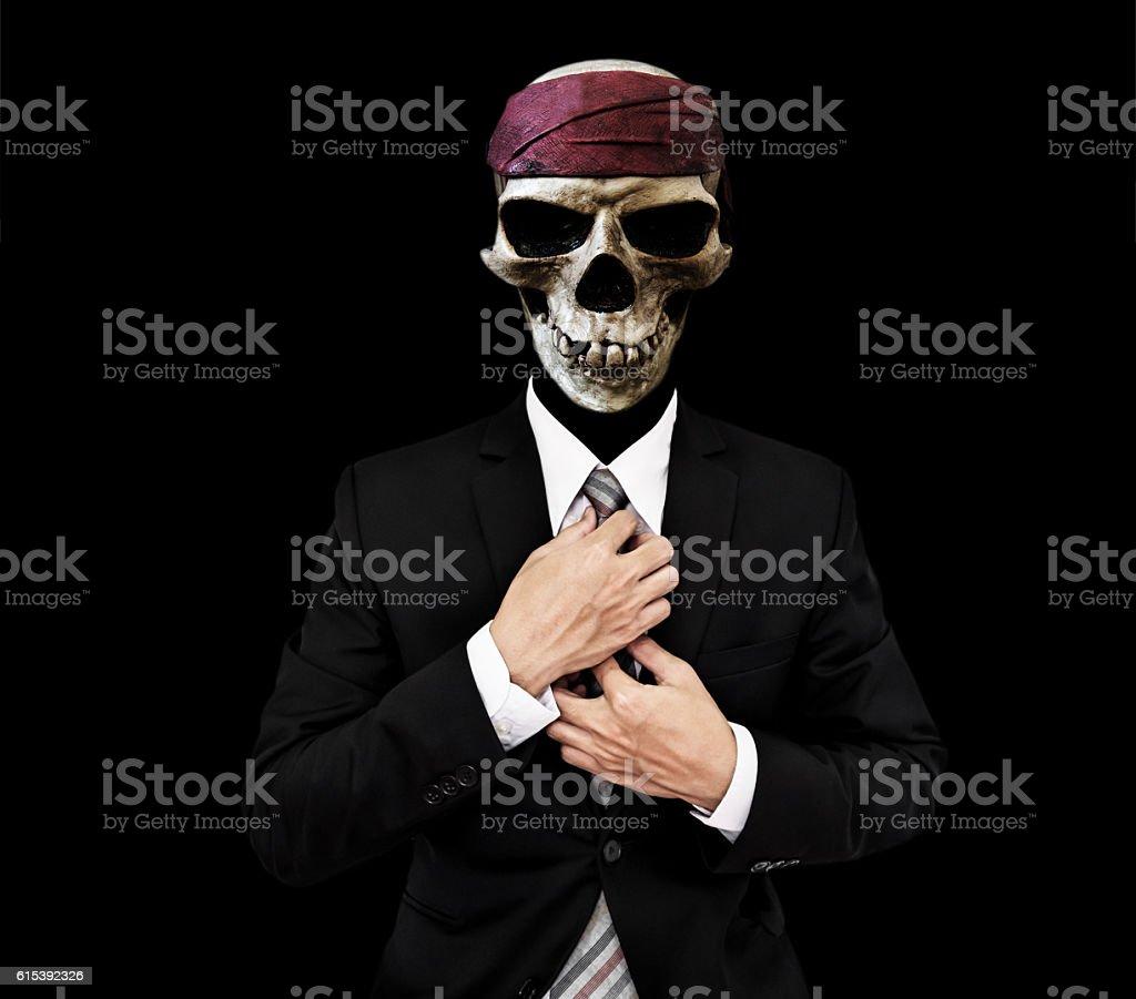 Skull Businessman in black suit, on black background stock photo