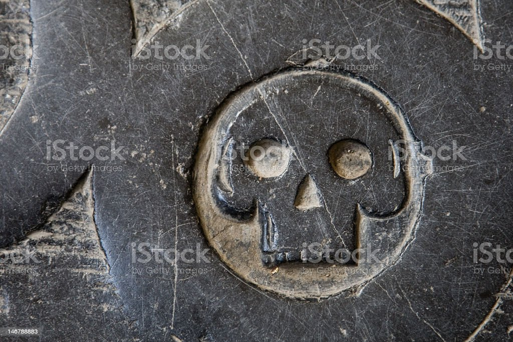Skull cap on tombstone stock photo