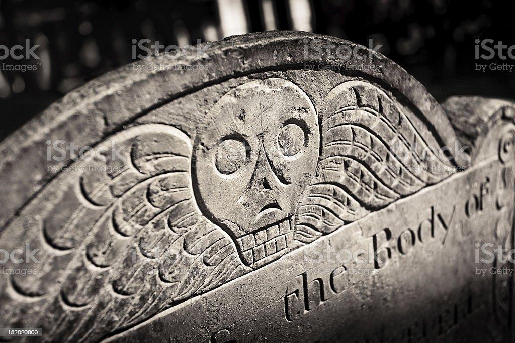 Skull headstone stock photo