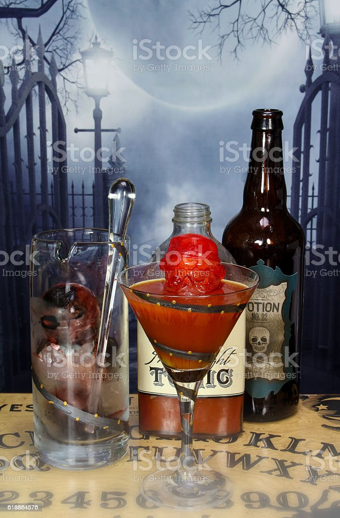 Skull Ice Cube Peaks Out of Drink stock photo