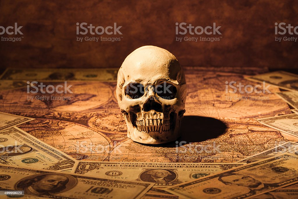 Skull on bank note and vintage map. stock photo