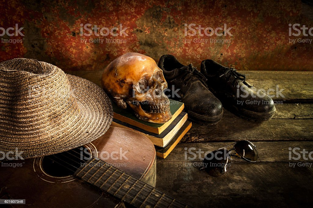 Skull on book and hat,guitar,glasses,shoes stock photo