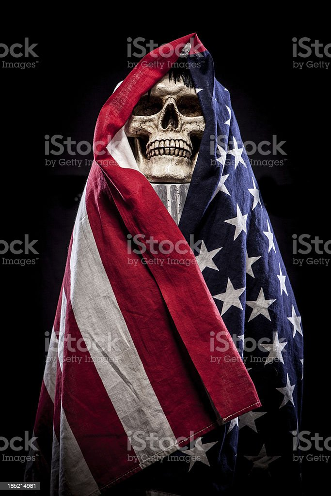 Skull on Pedestal Wrapped in American Flag, Closeup royalty-free stock photo