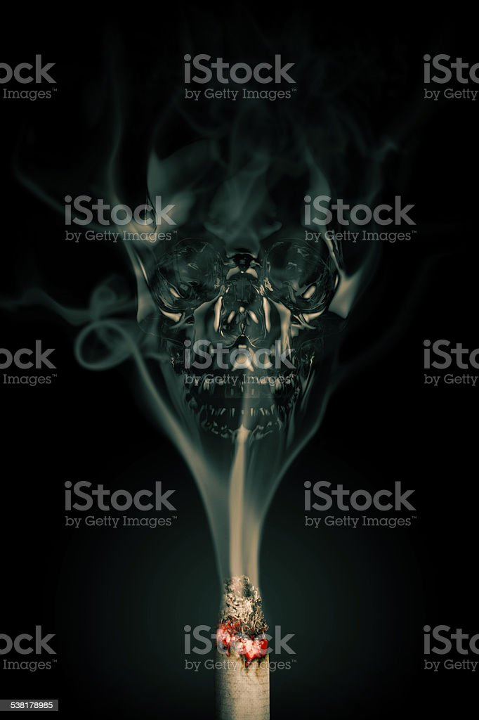 Skull shaped smoke comes out from cigarette on black stock photo