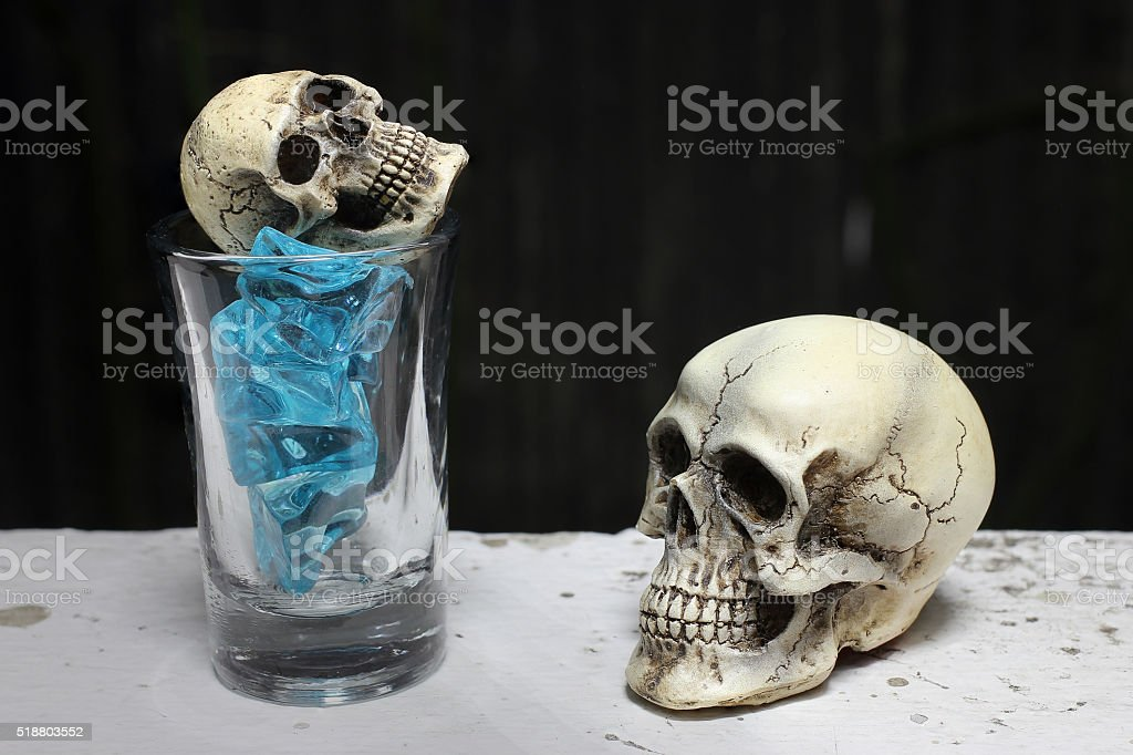 skull with Blue Ice in shot glass. -still life stock photo